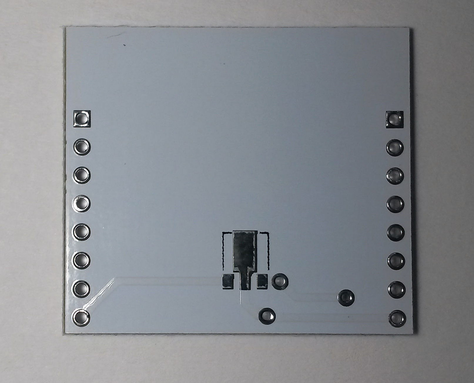 Minimal ESP-12 breakout - bottom side. You can see a place for SOT89 voltage regulator with pinout (from left): Gnd, Vin, Vout