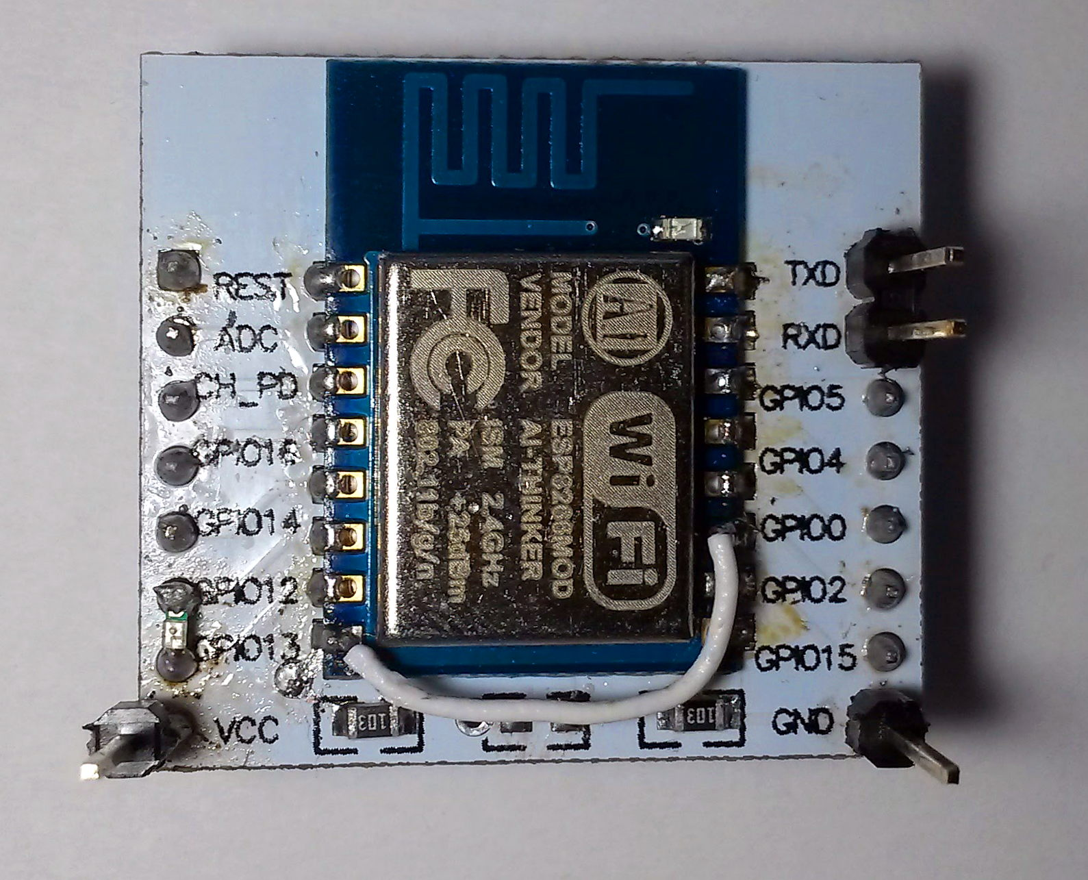 Top view on the assembled board. Single 0603 resistor and a piece of wire is needed to boot ESP from flash.